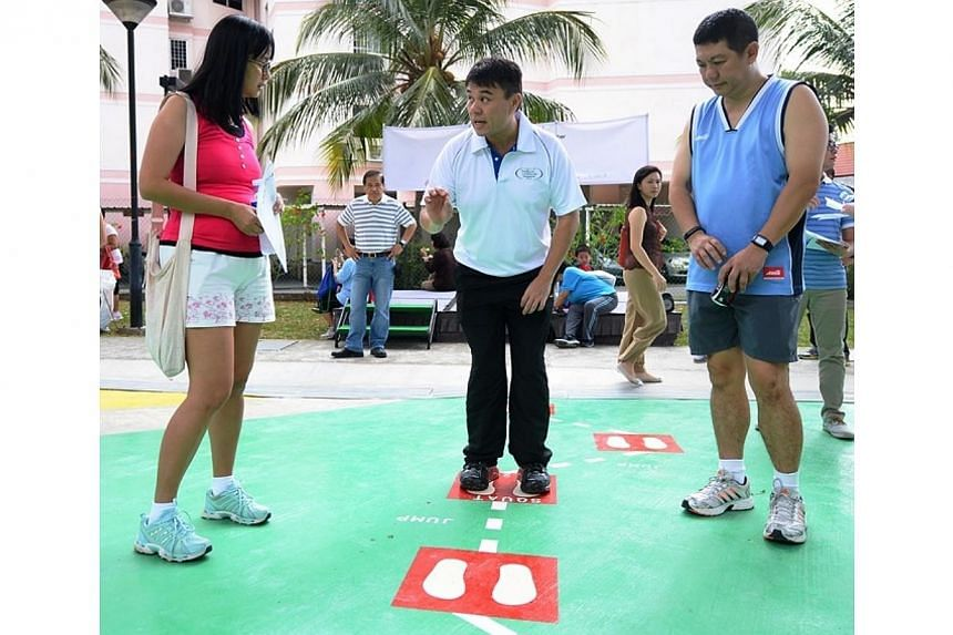 EIMS-Certified Fitness Instructor, Raymond shows Simei residents how to best make use of the exercise equiment.Residents living near Simei can now enjoy a new fitness corner that features equipment for a broad range of users. -- PHOTO: NA