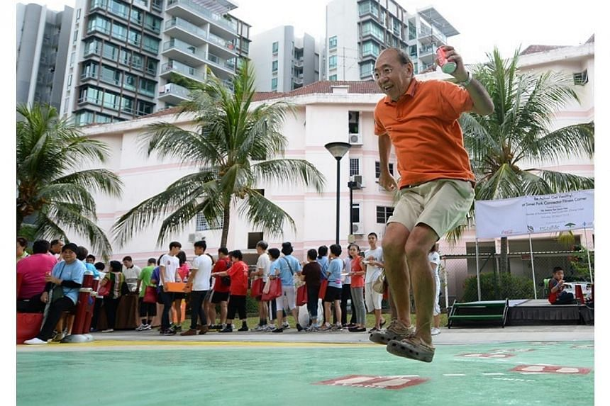 Residents of Simei at the opening for the FIRST Exercise is Medicine Singapore Compliant Fitness Corner, on March 29, 2014. -- PHOTO: NATIONAL PARKS BOARD