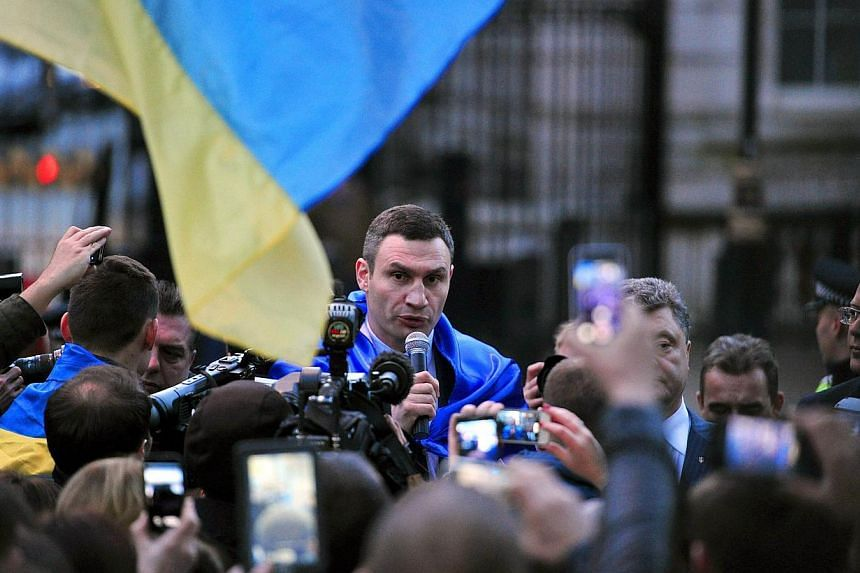 Ukrainian boxer-turned-politician Vitaly Klitschko pulled out of the race for president on Saturday, March 29, 2014, throwing his weight instead behind billionaire confectionary oligarch Petro Poroshenko. -- FILE PHOTO: AFP