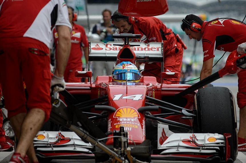 Ferrari driver Fernando Alonso of Spain enters the pits during the third practice session of the Formula One Malaysian Grand Prix in Sepang on March 29, 2014. -- PHOTO: AFP