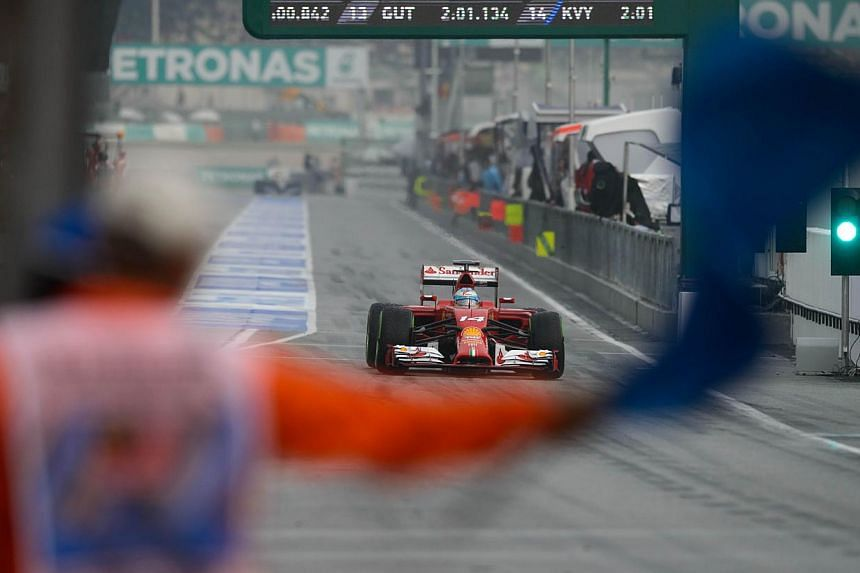 Ferrari driver Fernando Alonso of Spain takes part in the first qualifying session of the Formula One Malaysian Grand Prix at the Sepang circuit near Kuala Lumpur on March 29, 2014. -- PHOTO: AFP