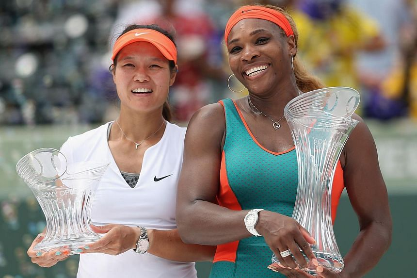 Serena Williams (right) of the United States holding the Butch Buchholz trophy after her straight sets victory against Li Na of China during their final match on day 13 of the Sony Open at Crandon Park Tennis Cente on March 29, 2014 in Key Biscayne,
