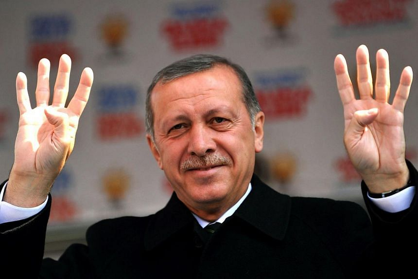 Turkish Prime Minister Recep Tayyip Erdogan waves to the crowd during a rally of the Justice and Development Party in the Kartal district at the asia side of Istanbul on March 29, 2014. -- PHOTO: AFP