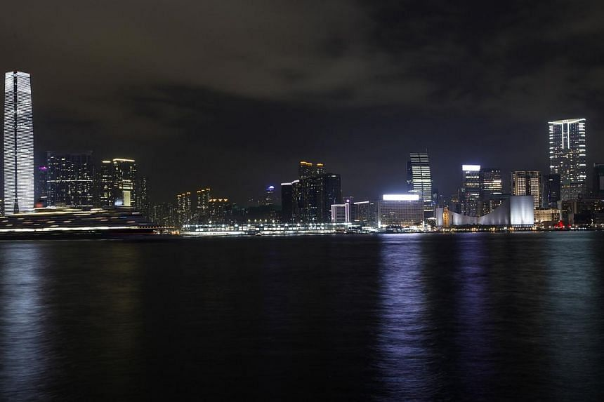 Kowloon peninsula, with Hong Kong's highest skyscraper International Commerce Centre, is seen across the harbour before Earth Hour on March 29, 2014. -- PHOTO: REUTERS