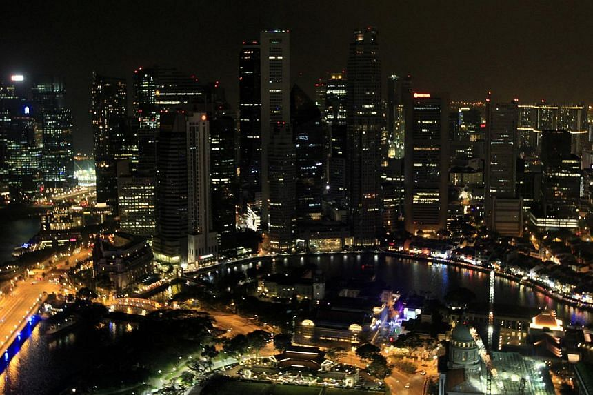 The Marina Bay Sands is pictured with its lights turned off during Earth Hour in Singapore on March 29, 2014. -- PHOTO: AFP