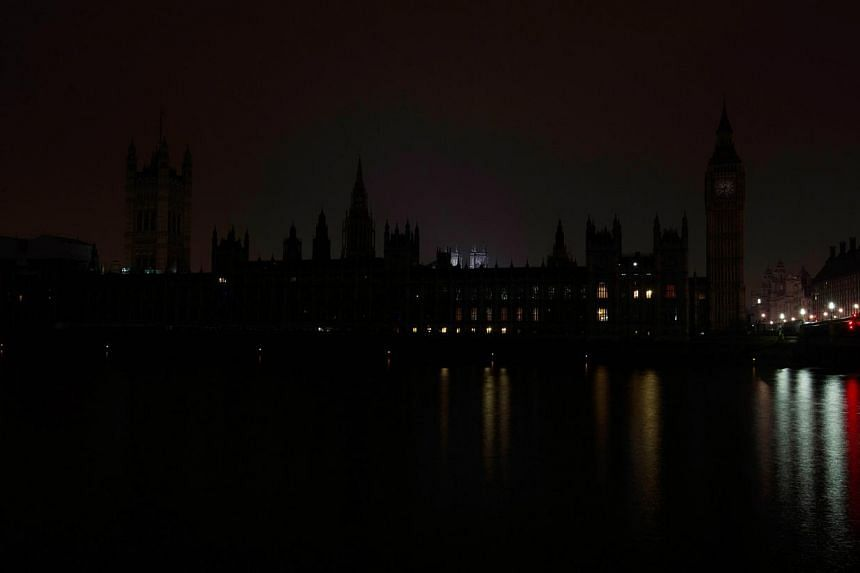 The House of Parliament in central London illuminated out to mark Earth Hour on March 29, 2014. -- PHOTO: AFP