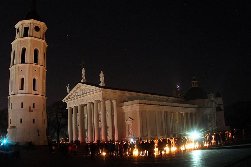 A picture taken on March 29, 2014 shows the Vilnius Cathedral with the lights switched off to mark the annual Earth Hour in Vilnius, Lithuania. -- PHOTO: AFP