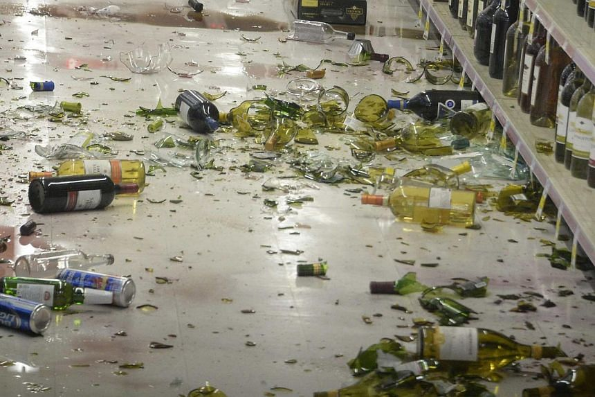Broken bottles are seen on the floor after falling off the shelves at a CVS pharmacy, following a magnitude 5.1 earthquake in Fullerton, California, on March 29, 2014. -- PHOTO: REUTERS