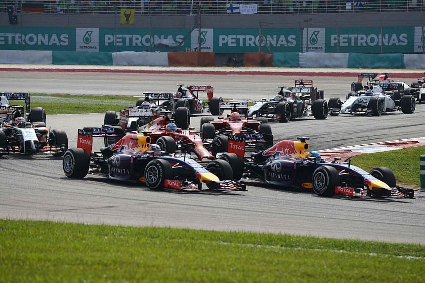 Drivers take the first corner at the start of the Formula One Malaysian Grand Prix at the Sepang circuit near Kuala Lumpur on March 30, 2014. -- PHOTO: AFP