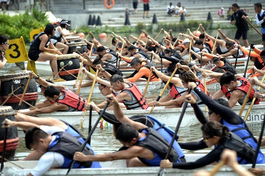 Competitors paddling off to a start for the Inter-generation dragon boat race at the PA PaddleFest organised by the People's Association. More than 4,000 people took part in dragon boating and kayaking races at Jurong Lake on Saturday, March 29, 2014