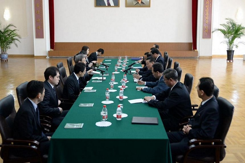 Junichi Ihara (fourth left), Japanese Foreign Ministry director general, talks to North Korea's ambassador for talks to normalise relations with Japan, Song Il-Ho (fourth right), at the North Korean embassy in Beijing on March 30, 2014. Japan and Nor