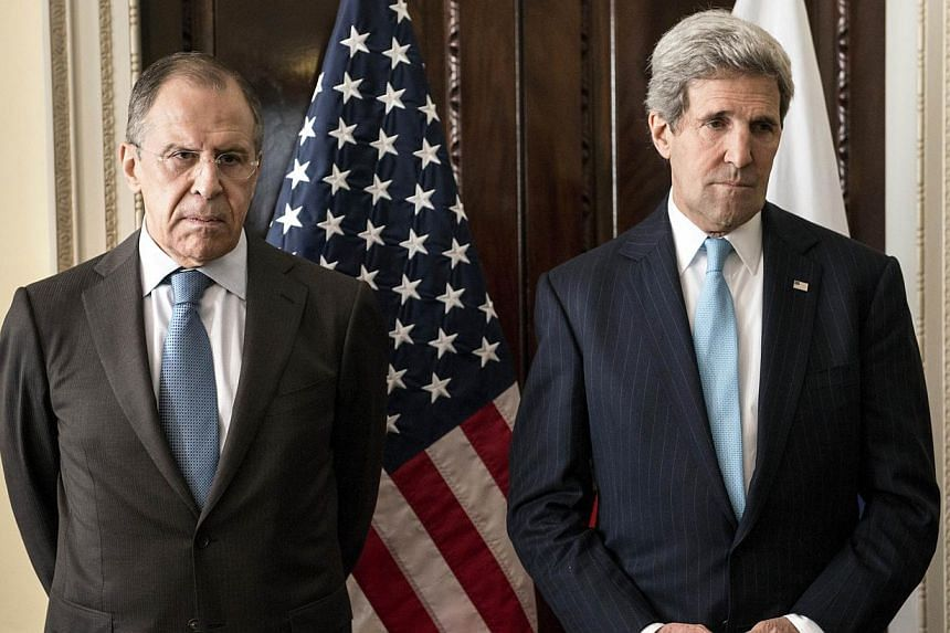 Foreign Minister Sergey Lavrov (left) and US Secretary of State John Kerry at an earlier meeting in London on March 14, 2014. -- FILE PHOTO: AFP