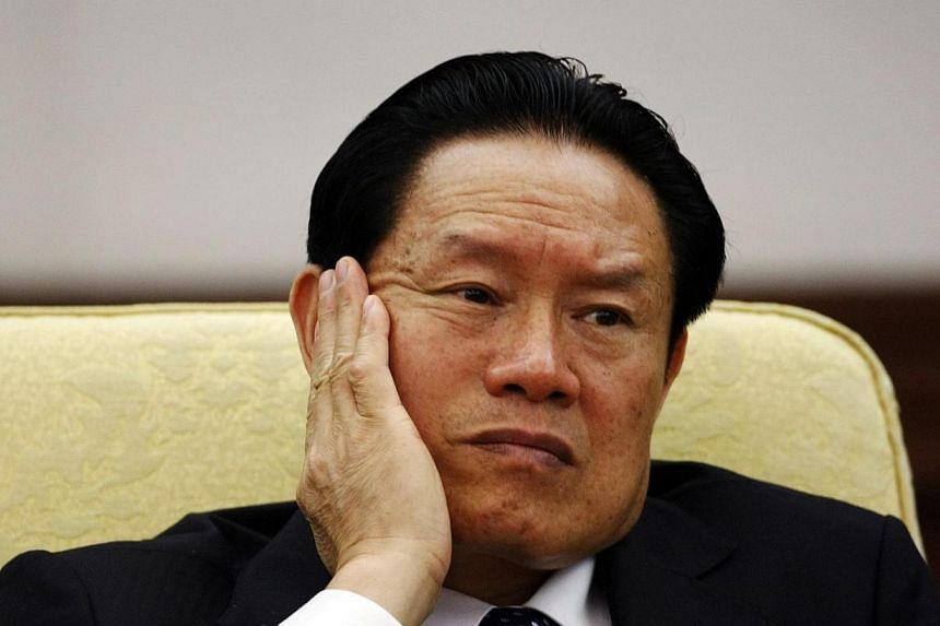 Chinese authorities have seized assets worth at least 90 billion yuan (S$18 billion) from family members and associates of retired domestic security tsar Zhou Yongkang, who is at the centre of China's biggest corruption scandal in more than six decad