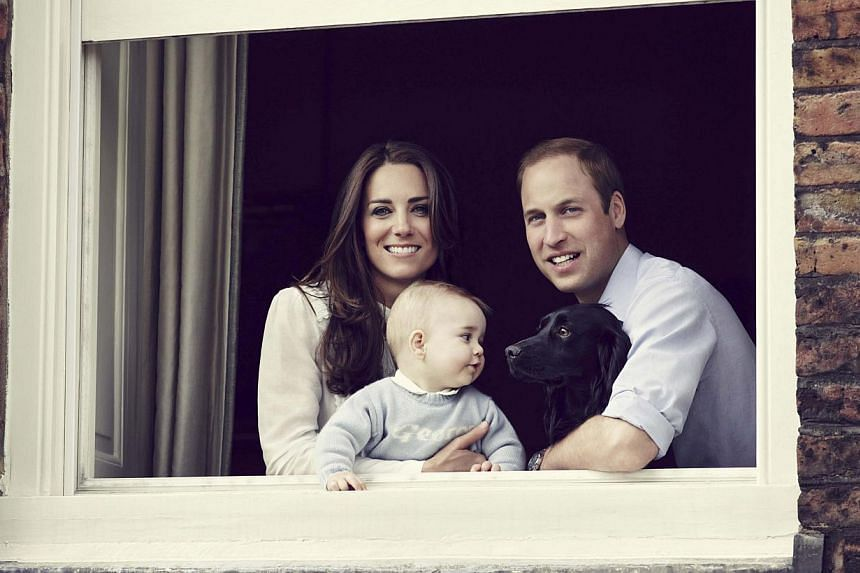 Britain's Prince William, Catherine, Duchess of Cambridge and their son Prince George, are seen in this photograph taken in Kensington Palace in mid-March 2014 and received in London on March 29, 2014. -- PHOTO: REUTERS