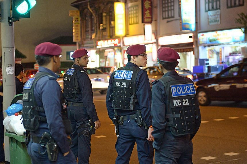 Police Tactical Unit officers on patrol at Geylang Road at 2am on March 29, 2014. -- ST PHOTO: DESMOND WEE