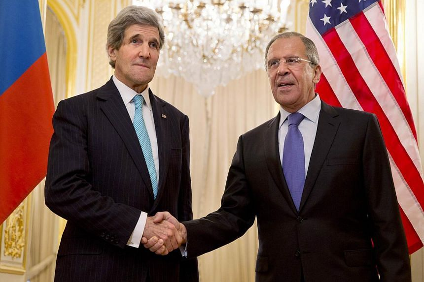 US Secretary of State John Kerry (left) shakes hands with Russian Foreign Minister Sergei Lavrov before their meeting at the Russian Ambassador's residence in Paris on March 30, 2014. -- PHOTO: REUTERS