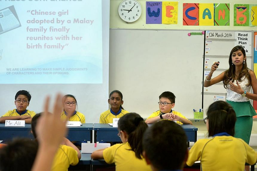 Primary 6 pupils of Punggol Primary School taking part in a mock press conference with English teacher Priyadakshini Surendiran. Some posed as reporters and others as characters in a story about Sallamah, a Chinese girl adopted by a Malay family. --