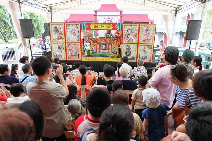 The audience watching a story-telling performance, that is rarely seen nowadays, during an event called Reliving Haw Par Villa in March 2014. -- FILE PHOTO: SINGAPORE TOURISM BOARD