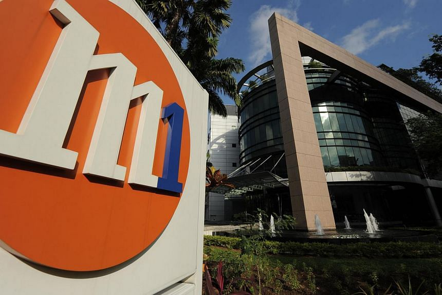 Telecommunications company M1's 2 million mobile users will be able to make calls and send SMS and MMS messages for free every Sunday next month. -- FILE PHOTO: M1 LIMITED