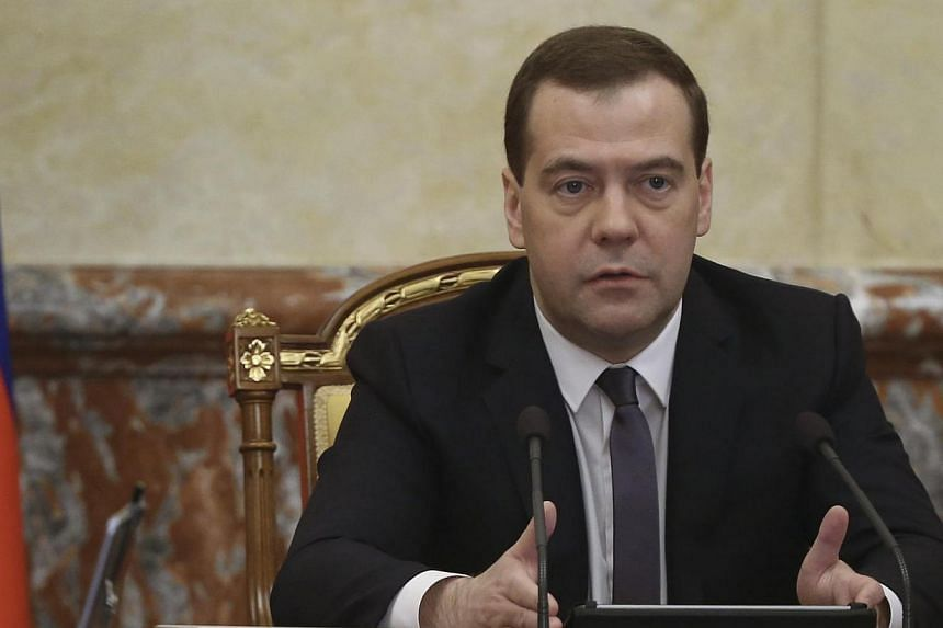 Russia's Prime Minister Dmitry Medvedev speaks during a meeting of the government in Moscow March 27, 2014. Prime Minister Dmitry Medvedev visited Crimea on Monday, March 31, 2014, the first Russian leader to travel to the Black Sea region after Mosc