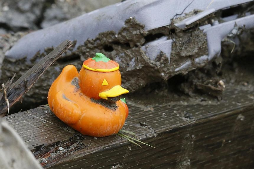 An orange duck sits among personal effects belonging to victims of a mudslide outside the decontamination tent in Oso, Washington, on March 30, 2014. -- PHOTO: REUTERS