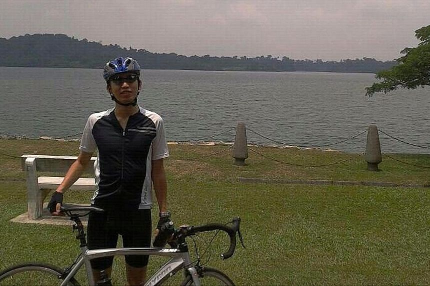 A NATIONAL serviceman is in critical condition after suffering serious head injuries following an accident during the OCBC Cycle Singapore on Sunday, March 30, 2014. -- PHOTO:CHIA JIA YIN