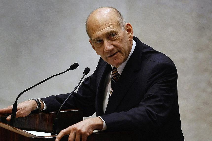 Tel Aviv district court on Monday, March 31, 2014, convicted former prime minister Ehud Olmert in a trial for corruption linked to a major property development in Jerusalem, Israeli media reports said. -- PHOTO: REUTERS