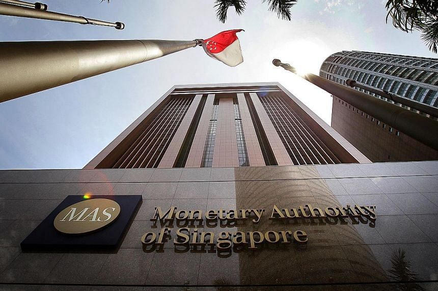 Growth in bank lending in Singapore eased in February for the third month in a row, owing to a slowdown in the loans disbursed to businesses.-- ST PHOTO:KEVIN LIM