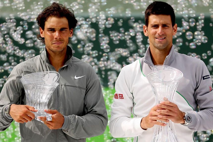 Rafael Nadal of Spain and Novak Djokovic (right) of Serbia pose for photographers after the final of the Sony Open at the Crandon Park Tennis Center in Key Biscayne, Florida, on March 30, 2014. -- PHOTO: AFP