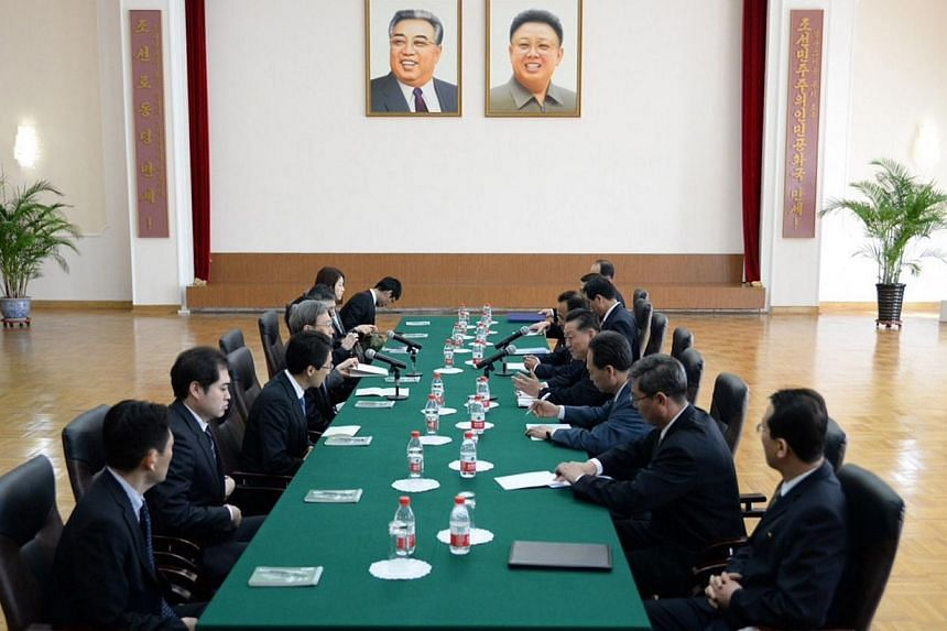 Junichi Ihara (fourth from left), Japanese Foreign Ministry director general, talks to North Korea's ambassador for talks to normalise relations with Japan, Song Il-Ho (fourth from right), at the North Korean embassy in Beijing on March 30, 2014. Gov