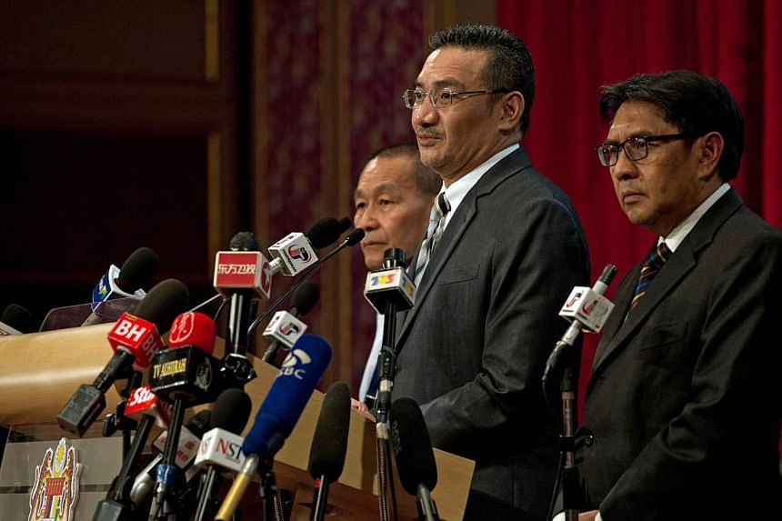 Malaysian Defence Minister Hishammuddin Hussein (second from right) delivers a statement on missing Malaysia Airlines flight MH370 to the media at the Putra World Trade Center (PWTC) in Kuala Lumpur on March 31, 2014. Malaysia Acting Transport Minist