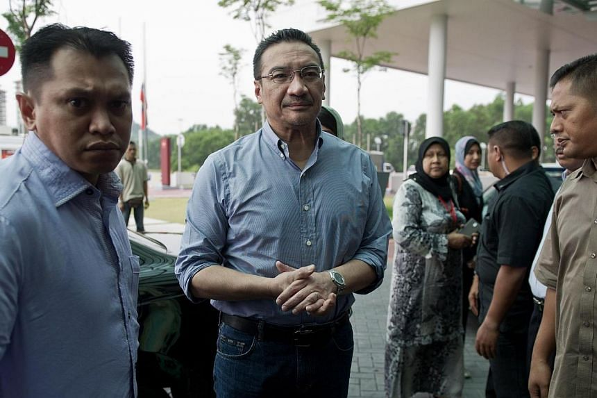 Malaysia's Transport Minister Hishammuddin Hussein (centre) arriving at a hotel for relatives of passengers of the missing Malaysia Airlines flight MH370 in Putrajaya, on March 29, 2014.A high-level briefing by technical experts is to be held f