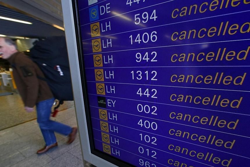 A flight information board inform passengers about cancelled flights during a strike at Frankfurt airport on March 27, 2014.Lufthansa, Germany's biggest airline, said on Monday, March 31, 2014, that it will cancel most of its flights later this
