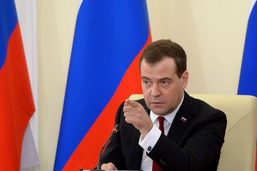 "Russia's Prime Minister Dmitry Medvedev speaks at meeting in the Crimean capital Simferopol on Monday, March 31, 2014. Ukraine on Monday denounced the visit of Russian Prime Minister Dmitry Medvedev to Crimea, describing it as a ""crude violation"
