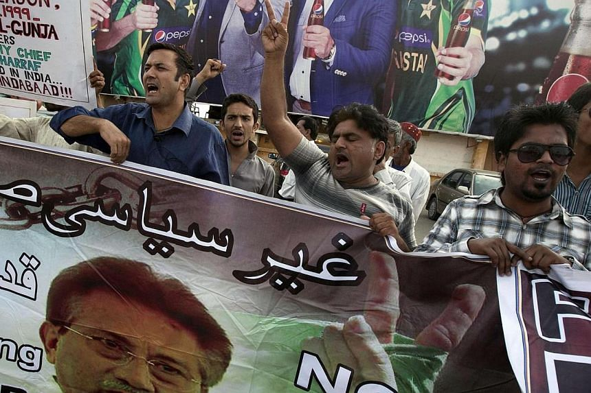 Supporters of former president Pervez Musharraf, head of the All Pakistan Muslim League (APML) political party, chant slogans during a protest demanding a fair trial for him in Karachi on March 30, 2014.Mr Musharraf, on Monday, March 31, 2014,