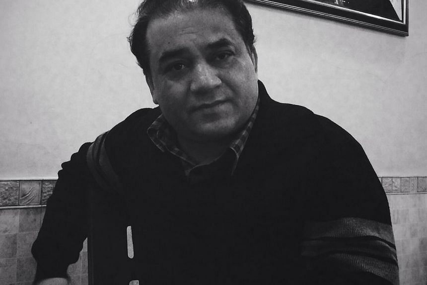 Ilham Tohti, an economics professor at Beijing's Minzu University, sits in a restaurant in Beijing, in this handout picture taken Jan 8, 2014. China's foreign ministry expressed anger on Tuesday after the prominent detained Uighur academic won a
