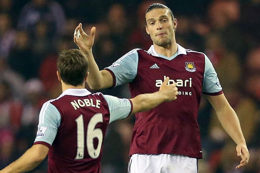 West Ham United's English striker Andy Carroll (right) celebrates after scoring the opening goal with West Ham United's English midfielder Mark Noble during the English Premier League football match between Sunderland and West Ham United at The S