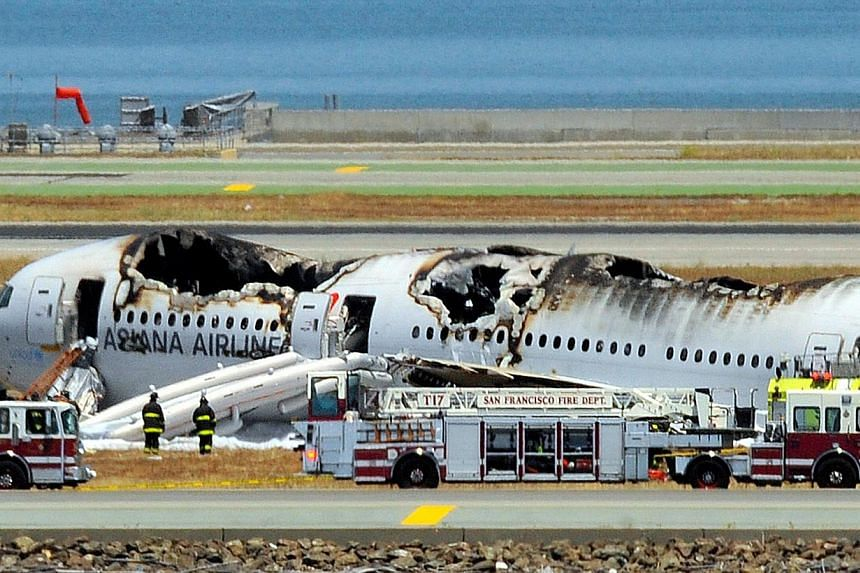 Asiana Airlines Flight 214 is seen on the runway at San Francisco International Airport after crash landing on July 6, 2013. -- FILE PHOTO: AFP