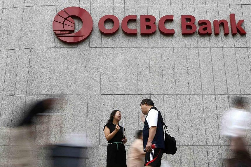 OCBC Bank announced on April 1, 2014 its keenly-awaited bid to acquire Hong Kong-listed Wing Hang Bank, at HK$125 per share or HK$38.4 billion (S$6.2 billion) in cash. -- PHOTO: REUTERS