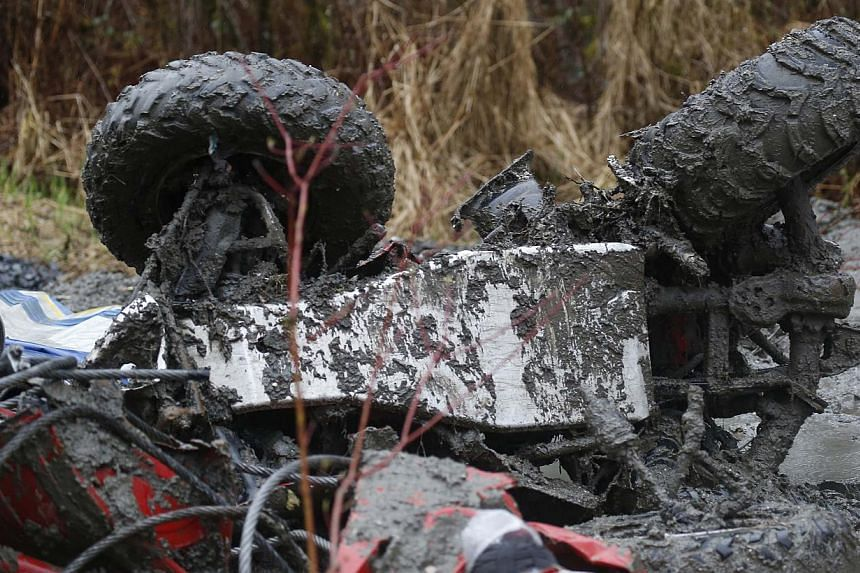 A wrecked ATV is seen at the scene of a massive mudslide in Oso, Washington, on March 28, 2014. -- FILE PHOTO: REUTERS