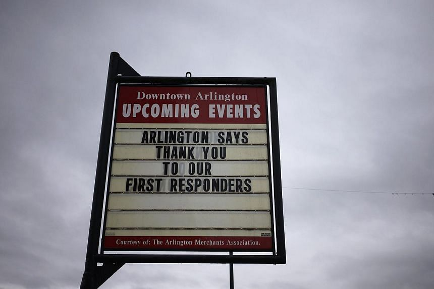 A sign thanking emergency personnel responding to the nearby mudslide is seen in downtown Arlington, Washington, on March 28, 2014. -- FILE PHOTO: REUTERS