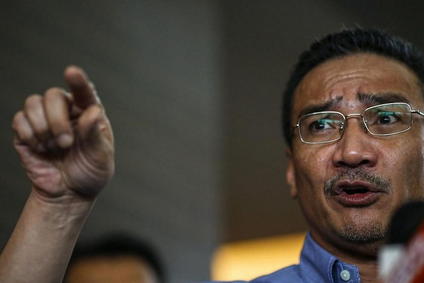 Malaysia's acting Transport Minister Hishammuddin Hussein gestures as he speaks about the search for the missing Malaysia Airlines Flight MH370, during a news conference at The Everly Hotel in Putrajaya on March 29, 2014. -- FILE PHOTO: REUTERS