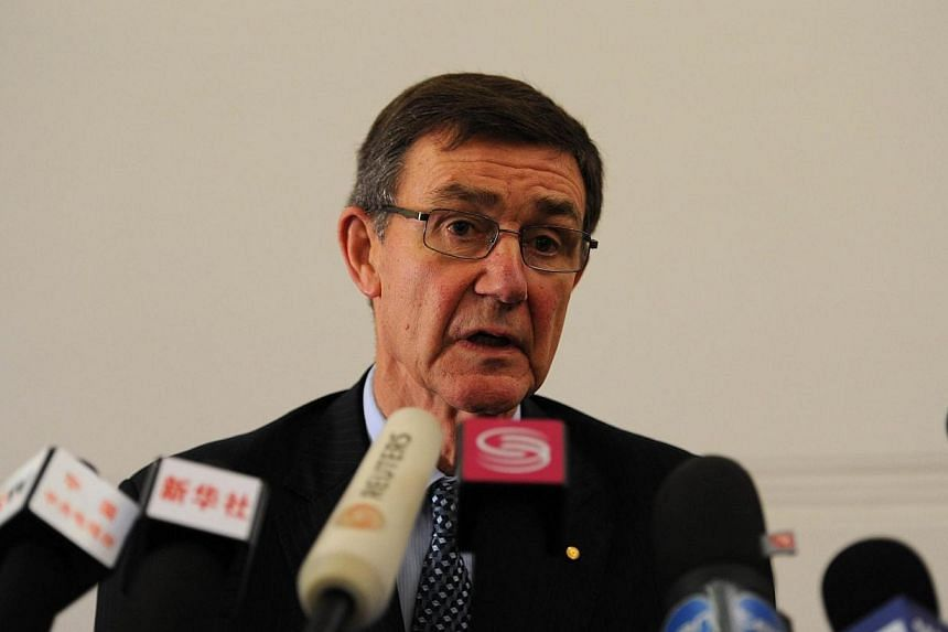 Retired Australian air chief marshall Angus Houston speaks about the missing Malaysia Airlines flight MH370 at a press conference in Perth on April 1, 2014. Australia warned on Tuesday, April 1, 2014, the hunt for missing Flight MH370 could be l