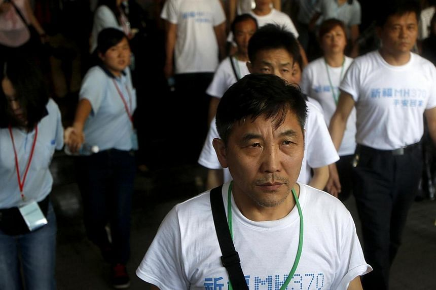 Chinese relatives of passengers onboard the missing Malaysia Airlines Flight MH370 leave their hotel in Subang for prayers at a Buddhist temple on Tuesday, March 31, 2014.Malaysian officials will hold a special briefing session for the families