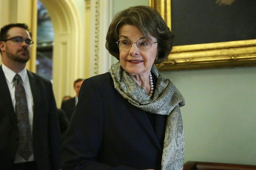 US Senator Dianne Feinstein (D-CA), who is also the chairman of the Senate Intelligence Committee, arrives at the weekly Senate Democratic Policy Committee luncheon March 25, 2014, at the Capitol in Washington, DC. A damning Senate report conclu