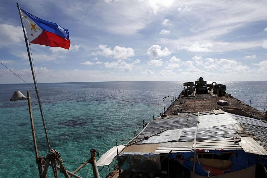 A Philippine national flag flutters in the wind aboard the BRP Sierra Madre, run aground on the disputed Second Thomas Shoal, part of the Spratly Islands, in the South China Sea on March 29, 2014.Chinese state media on Tuesday, April 1, 2014, a