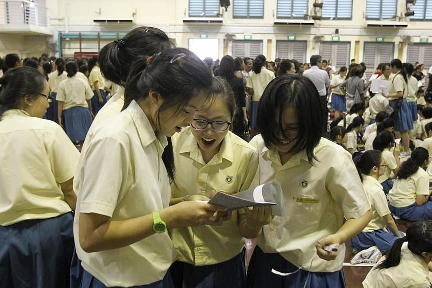 Students at Crescent Girls' Secondary School checking out one another's O-level results on Jan 10, 2013 when O-level results were released. Singapore's 15-year-olds don't just excel in mathematics, science and reading, they are also worl