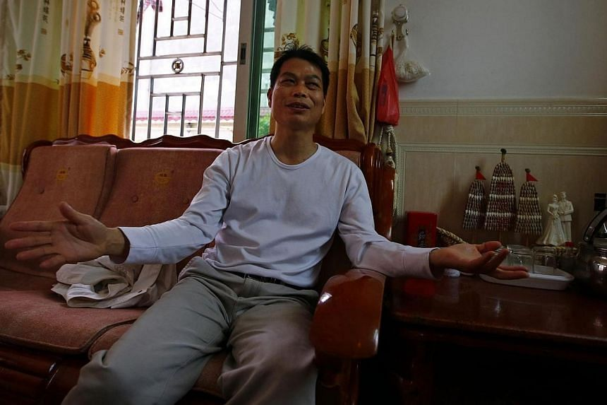 Mr Yang Semao, who is running for village chief in Wukan, Guangdong province, gestures during an interview with Reuters on March 30, 2014, a day before the election.Voters in a Chinese village that overthrew its Communist Party bosses in landma
