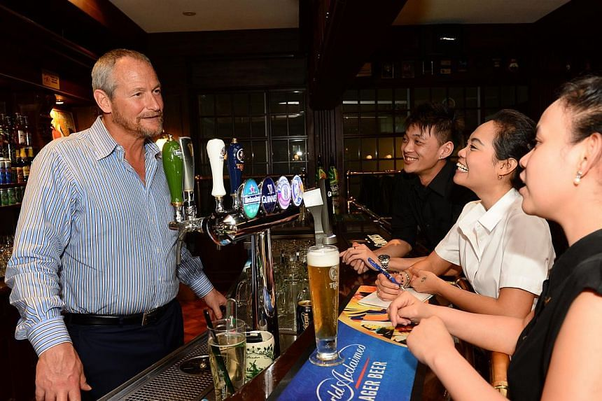 Mr Adam Chafetz and three trainers. -- PHOTO:ASIA PACIFIC BREWERIES SINGAPORE