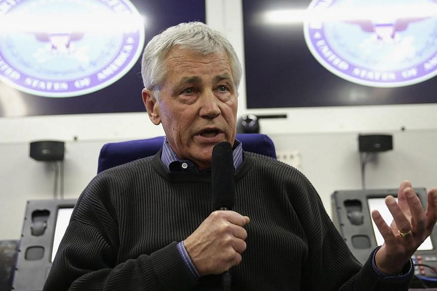US Secretary of Defence Chuck Hagel speaks to members of a travel press pool on April 1, 2014, en route Honolulu, Hawaii. The specter of missing Malaysia Airlines flight MH370 will loom over a meeting of US and Asean defence ministers on Wednesd